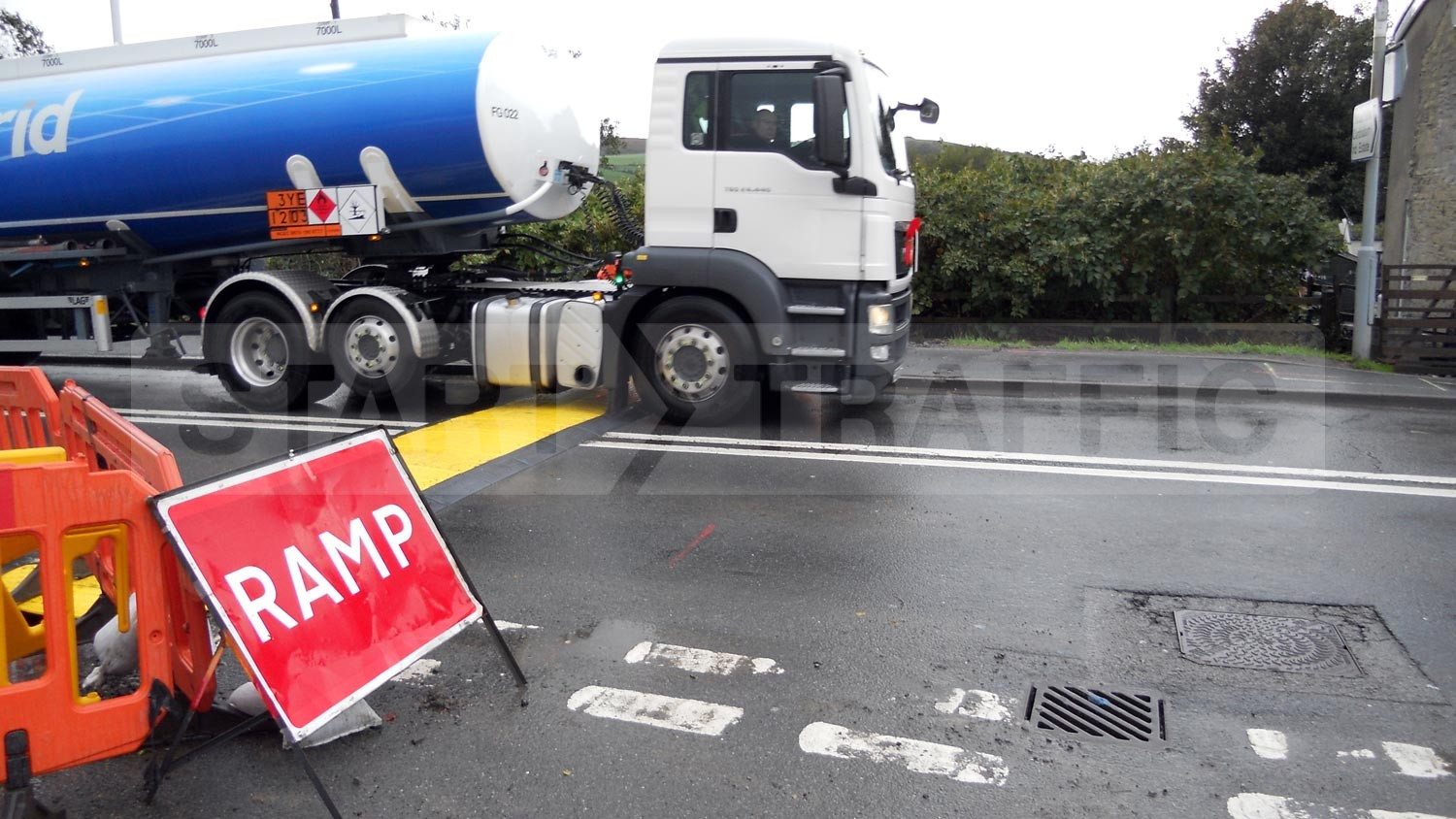 Lorry passing over road plate